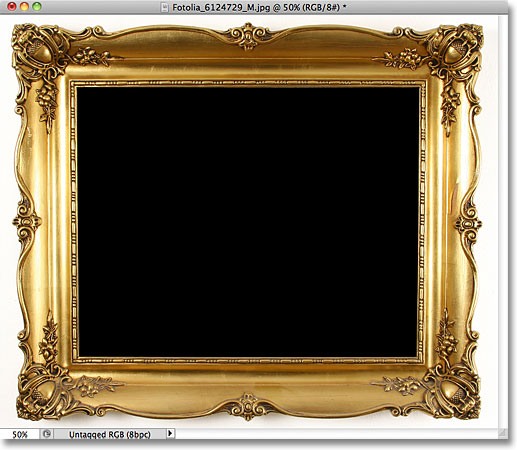 The area inside the photo frame has been filled with black. Image © 2011 Photoshop Essentials.com