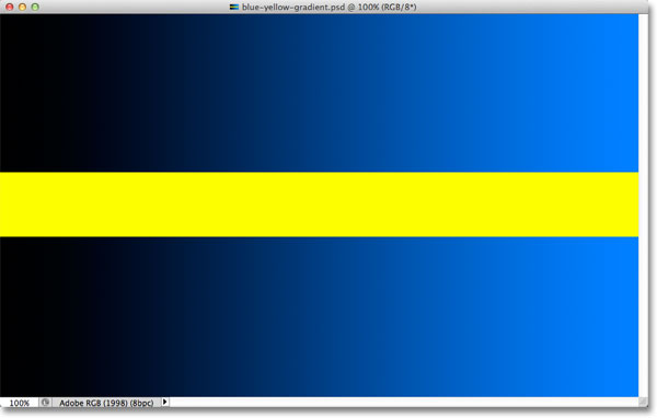 A dark to light blue gradient divided by a yellow horizontal bar. Image © 2012 Photoshop Essentials.com
