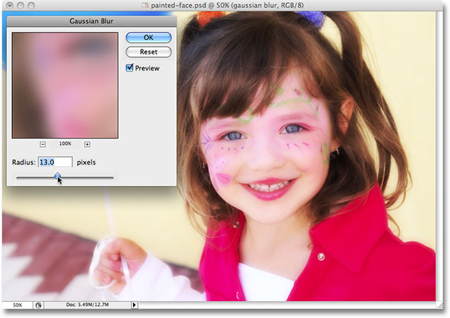 Photoshop pauses the action and displays the Gaussian Blur dialog box. Image used by permission from iStockphoto.com