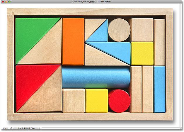 The color of the wooden block has been changed. Image © 2009 Photoshop Essentials.com