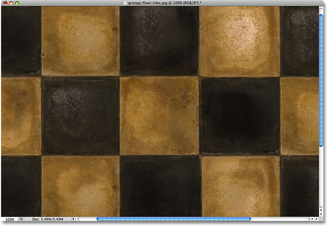 Grungy floor tiles. Image licensed from iStockphoto by Photoshop Essentials.com