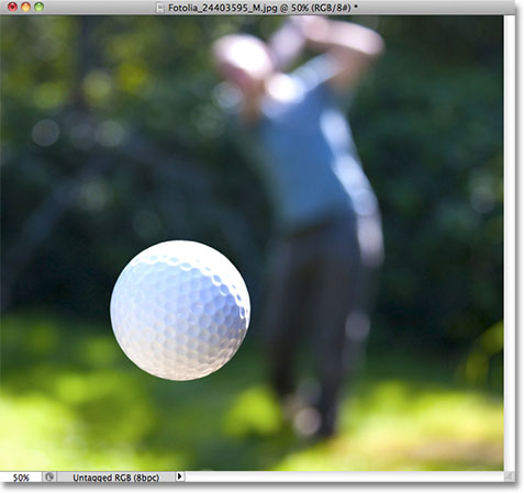 A close up photo of a golf ball. Image licensed from Fotolia by Photoshop Essentials.com