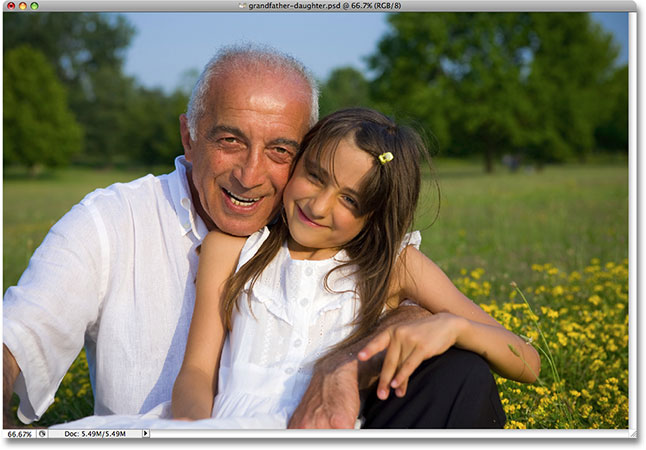 A photo of a grandfather with his grand daughter. Image licensed by Photoshop Essentials.com from iStockphoto.