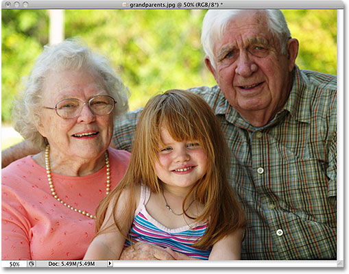 A photo of grandparents with their grand daughter. Image licensed from iStockphoto by Photoshop Essentials.com