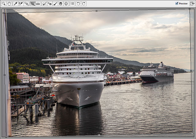 Camera Raw automatically draws a cropping border around the image. Image © 2013 Steve Patterson, Photoshop Essentials.com