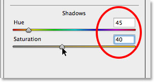 Setting the Hue and Saturation values for the Shadows section in the Split Toning panel. Image © 2014 Photoshop Essentials.com