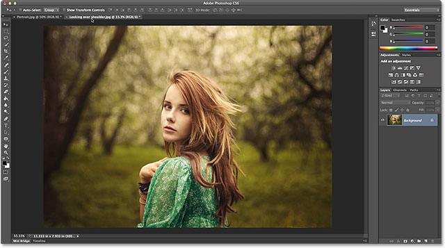 Making the landscape-oriented photo active by clicking its name tab. Image © 2014 Photoshop Essentials.com