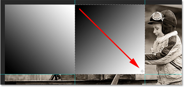 Drawing a second black to white gradient in the document. Image © 2014 Photoshop Essentials.com