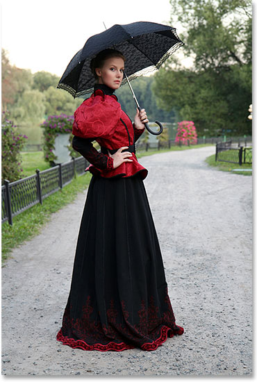 Girl with an umbrella in a vintage suit in a park. Image licensed from Shutterstock by Photoshop Essentials.com. Not to be used without permission.