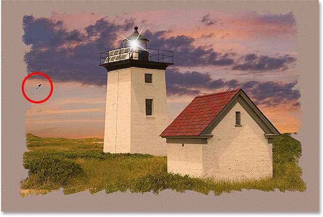 Sampling a yellow color from the light house to use as my canvas color. Image © 2013 Photoshop Essentials.com