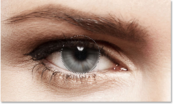 The image after applying the Radial Blur filter to the eye. Image © 2014 Photoshop Essentials.com.