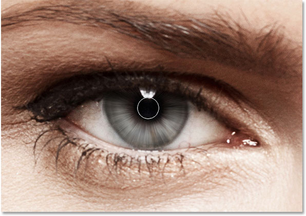 Painting away the blur streaks in the pupil of the eye. Image © 2014 Photoshop Essentials.com.