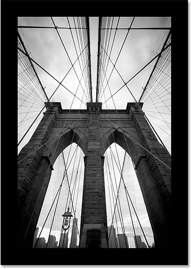 The border around the image has been changed from white to black. Image © 2014 Photoshop Essentials.com.