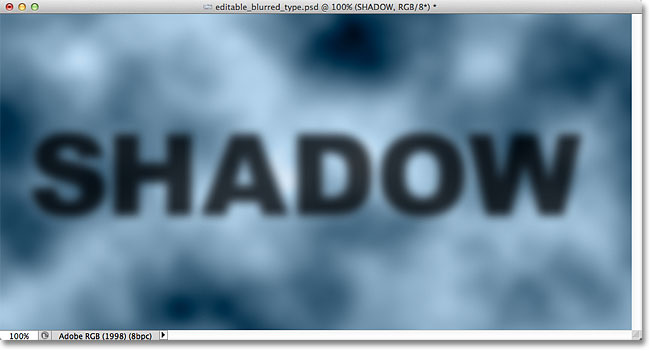 The blurred shadow text is now fully visible.