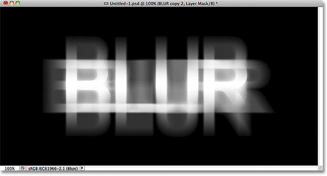 The text after drawing a reflected gradient on the layer mask. Image © 2011 Photoshop Essentials.com.