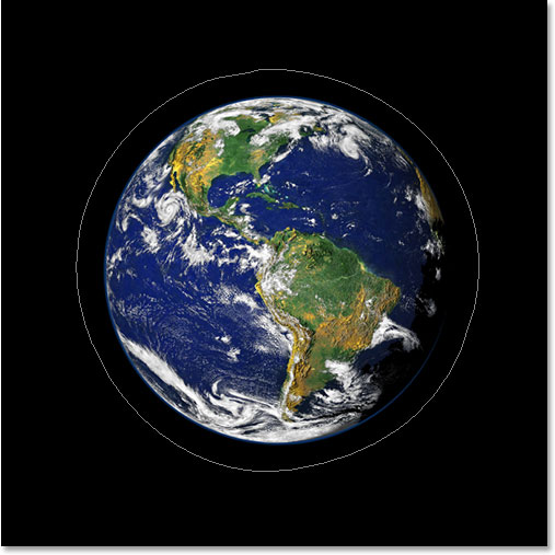 Adobe Photoshop Text Effects: The image now showing the path around the planet.